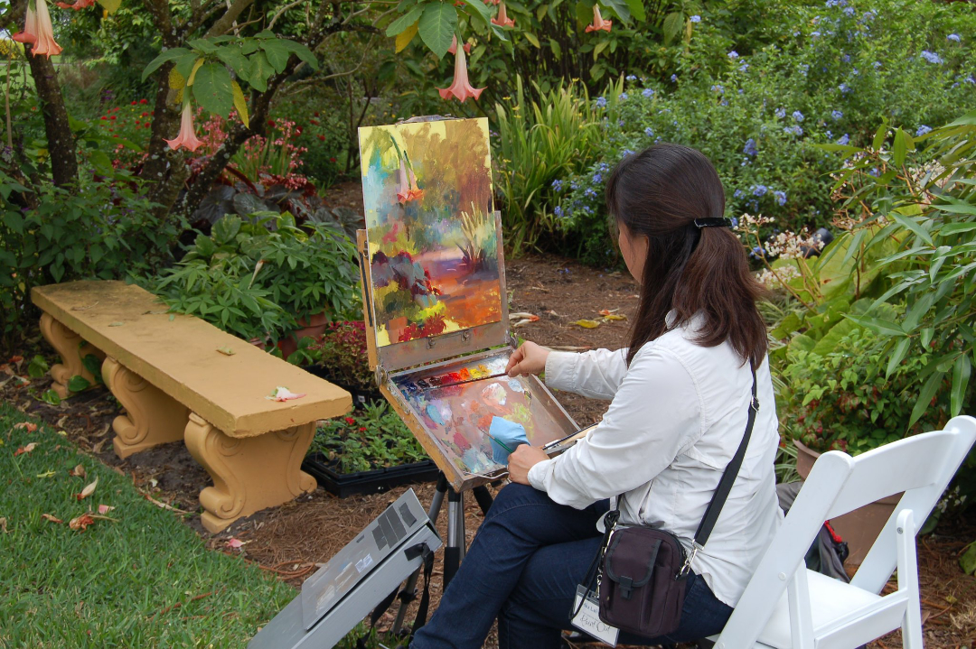 Woman painting in garden